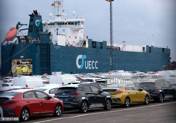 Cars are parked in a ferry at the harbour in Bremerhaven nothern Germany on January 25 2018 / AFP PHOTO / Patrik STOLLARZ