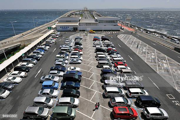 Cars are parked in a lot of the Umihotaru rest area off the Tokyo Bay AquaLine highway in Kisarazu Chiba prefecture Japan on Sunday April 26 2009...