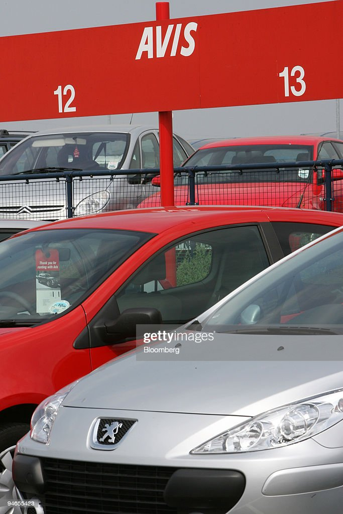 Cars Are Parked In An Avis Rental Lot At London City Airport In