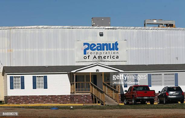 Cars are parked in front of the Peanut Corporation of America Plant February 5 2009 in Blakely Georgia The plant is linked to a nationwide salmonella...