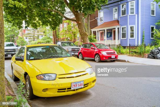 Cars are parked in residential neighborhood in Cambridge Boston Massachusetts