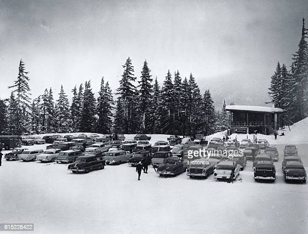 Cars are parked in the snow of the Bachelor Butte Lodge parking lot. Deschutes, Oregon. | Location: Deschutes, Oregon, USA.