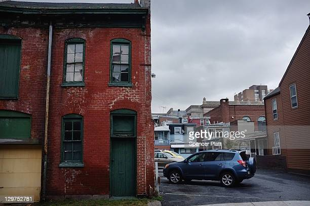 Cars are parked next to residential homes October 20, 2011 in Reading, Pennsylvania. Reading, a city that once boasted numerous industries and the...