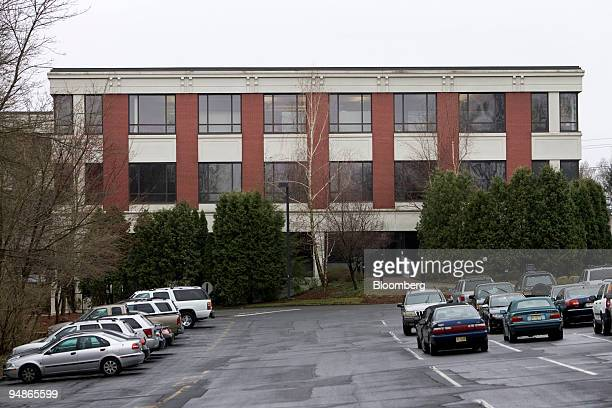 Cars are parked outside the building housing the headquarters of Appaloosa Management LP in Chatham New Jersey US on Friday April 4 2008 Delphi...