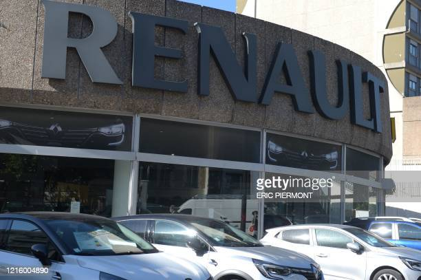 Cars are parked outside the French Renault dealership showroom in Boulogne Billancourt on May 29, 2020. - Renault said on May 29 it will cut nearly...