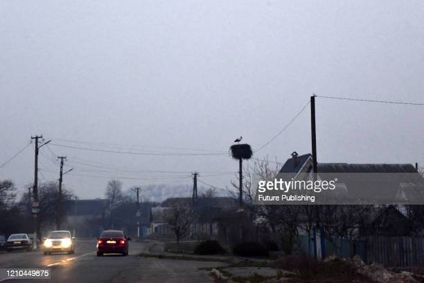 Cars are pictured on the road as the smoke from burning grass and forest floor pollutes the air in the region, Vyshhorod district, Kyiv Region,...