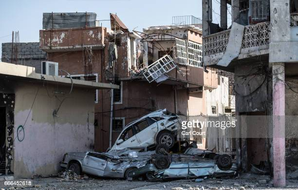 Cars are piled up to shield against snipers and suicide attacks during fighting against Islamic State in west Mosul on April 6 2017 in Mosul Iraq...