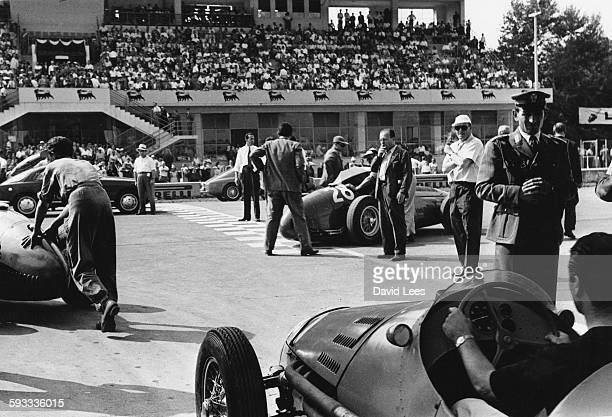 Cars are pushed onto the grid by their team mechanics before the start of the Italian Grand Prix on 5 September 1954 at the Autodromo Nazionale Monza...