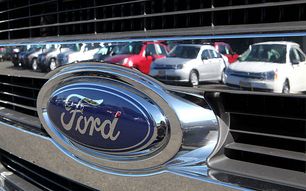 Cars are reflected in the grill of a new Ford truck November 2, 2009 in Richmond, California. Ford Motor rerported a nearly $1 billion third quarter...