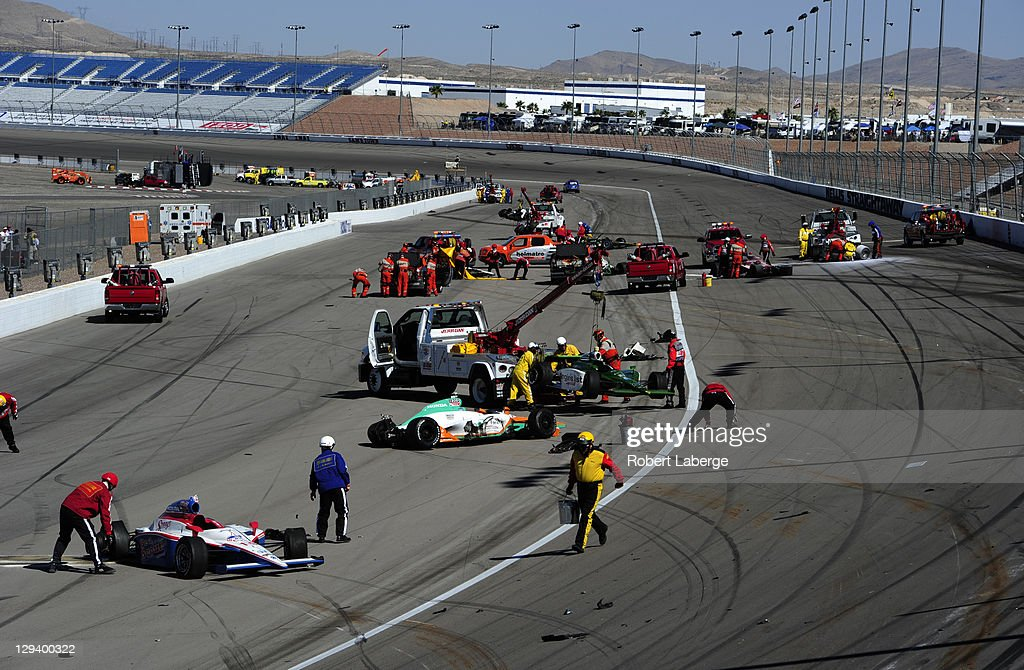 Cars are scattered on the track after a 15 car crash in which Dan