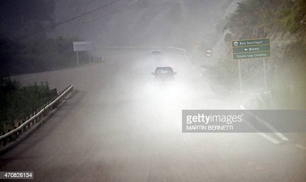 Cars are seen amid volcanic ashes from the Calbuco volcano in La Ensenada, on April 23, 2015. Chile's Calbuco volcano erupted on Wednesday, spewing a...
