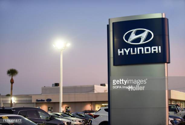 Cars are seen at a Hyundai car dealership Hyundai and Kia announced on October 11 2019 that they have agreed to settle a class action lawsuit over...