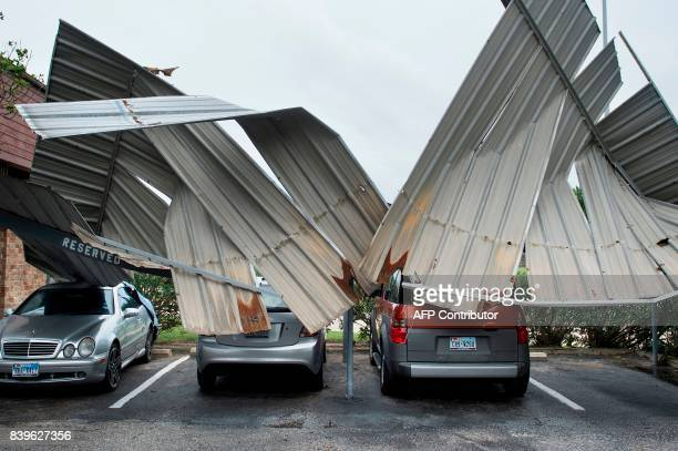 TOPSHOT Cars are seen below a collapsed shelter following the passage of Hurricane Harvey on August 26 2017 in Galveston Texas / AFP PHOTO / Brendan...