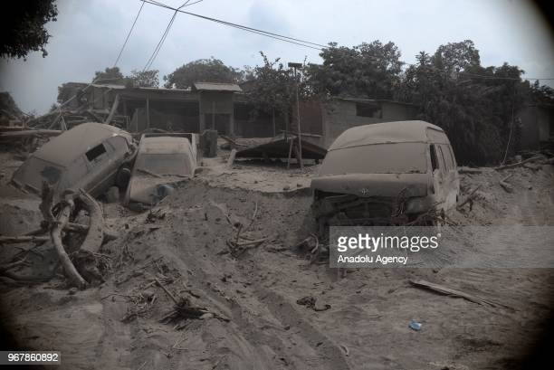 Cars are seen covered in ashes after the volcanic eruption in San Miguel Los Lotes village in Guatemala City Guatemala on June 05 2018 At least 69...