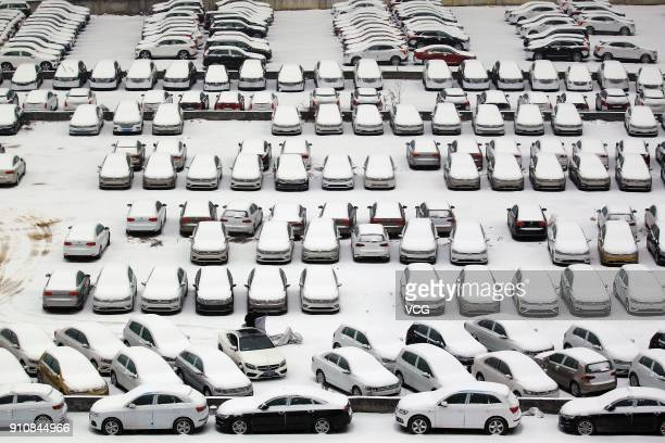 Cars are seen covered in snow after a heavy snowfall hit Wuhan on January 27 2018 in Wuhan Hubei Province of China