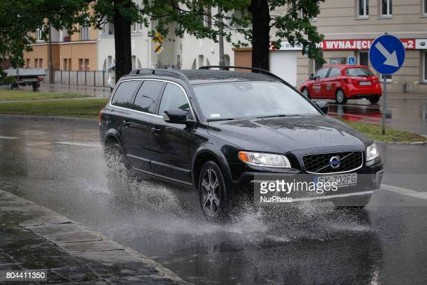 Cars are seen driving trough a large puddle in the center of Bydgoszcz Poland on 30 June 2017