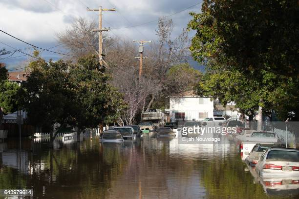 Cars are seen in floodwaters on February 22 2017 in San Jose California Flooding on Tuesday prompted the evacuation of over 10000 people in the area