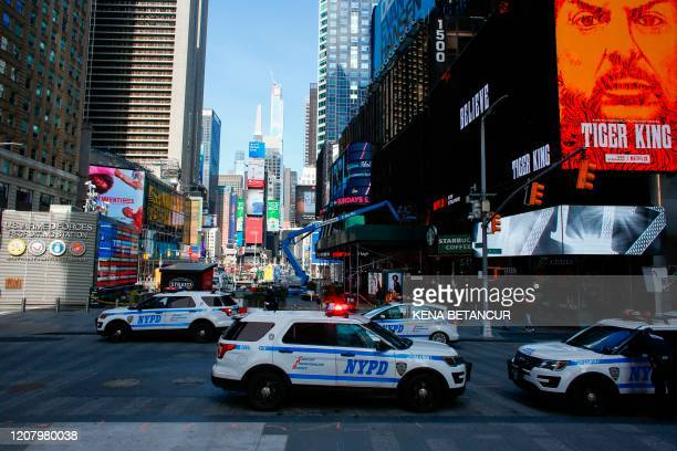 Cars are seen in Times Square on March 22, 2020 in New York City. - Coronavirus deaths soared across the United States and Europe on despite...