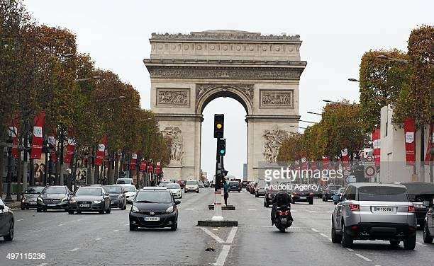 Cars are seen on a road at the Champs Elysee boulevard in Paris France on November 14 2015 following the attacks that left at least 128 people dead...