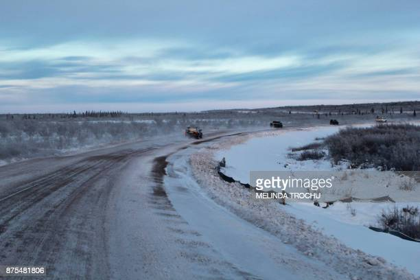 Cars are seen on the Inuvik Tuktoyaktuk highway on November 15 2017 in Inuvik Canada The Inuvik to Tuktoyaktuk highway opened on November 15 2017 The...