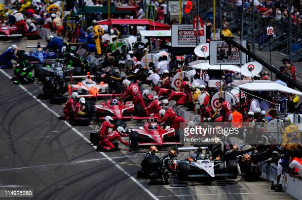Cars are serviced in the pits during the IZOD IndyCar Series Indianapolis 500 Mile Race at Indianapolis Motor Speedway on May 29 2011 in Indianapolis...