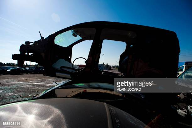 Cars are stored before the dismantling at the Indra Automobile Recycling centre in PruniersenSologne near Blois central France on April 7 2017 / AFP...