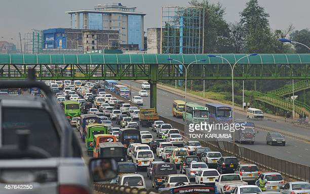 Cars are stuck in traffic on a motorway on October 22 2014 in the Kenyan capital Nairobi during a typical morning commute Plans by the government to...