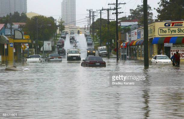 Cars are trapped in heavy flooding after severe weather hits the south east coast of Queensland causing torrential flooding June 30 2005 in Southport...