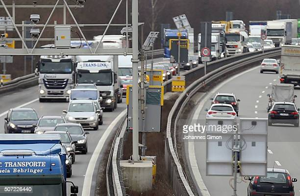 Cars arriving from Austria to Germany are queued in front of a police check point on the A3 highway near the border to Austria on a section used by...