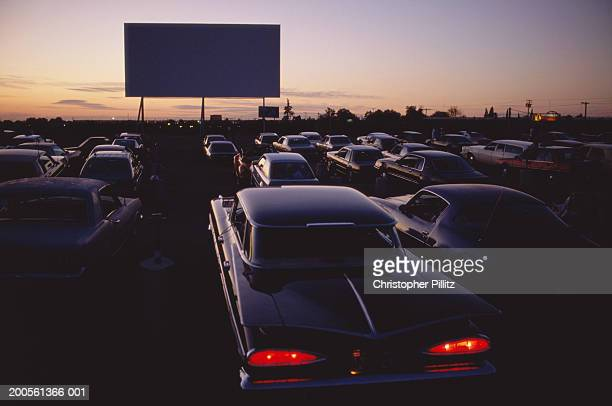 Cars at drive-in cinema at dusk