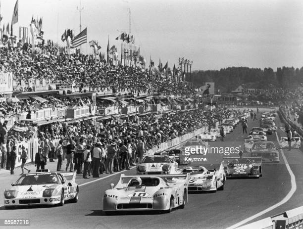 Cars at the start of the 24 Hours of Le Mans at the Circuit de la Sarthe France 14th June 1975 In the foreground are a Ligier JS2 and a Mirage GR8...