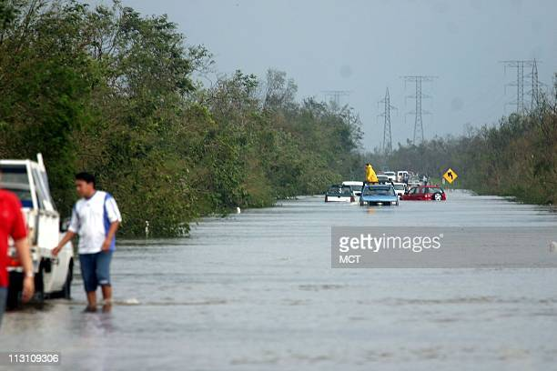 CANCUN MEXICO Cars attempt to cross flooded waters west of Cancun Mexico in the aftermath of Hurricane Wilma Sunday October 23 2005 The hurricane...