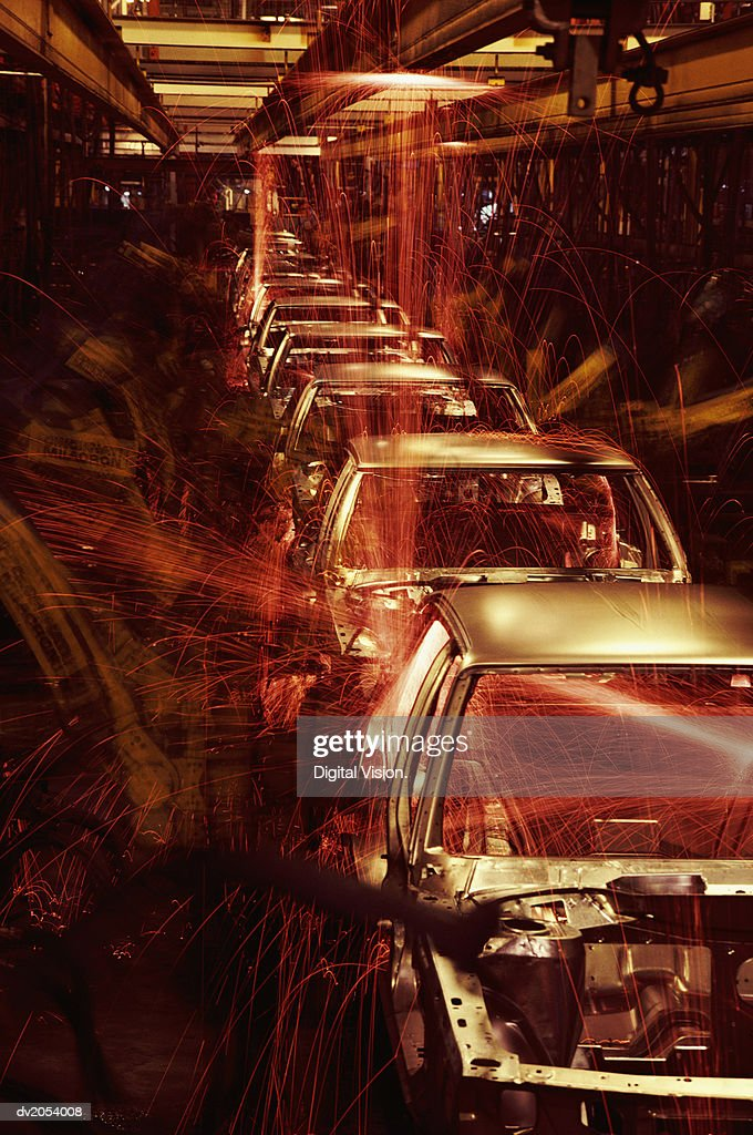 Cars Being Manufactured on a Factory Assembly Line : Stock Photo
