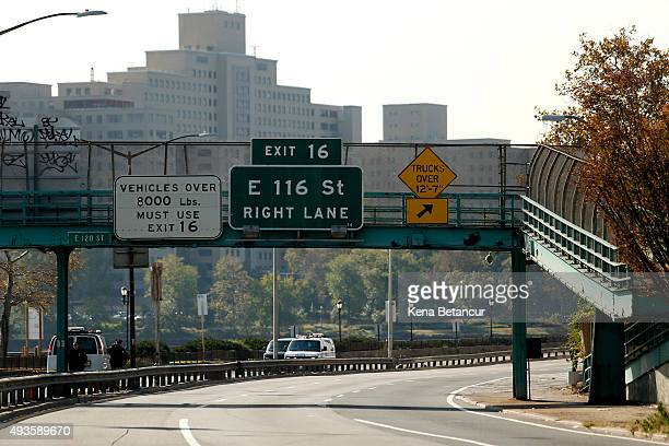 NYPD cars block the FDR as investigations continue after a NYPD officer was killed in a confrontation with an armed suspect fleeing police on a...