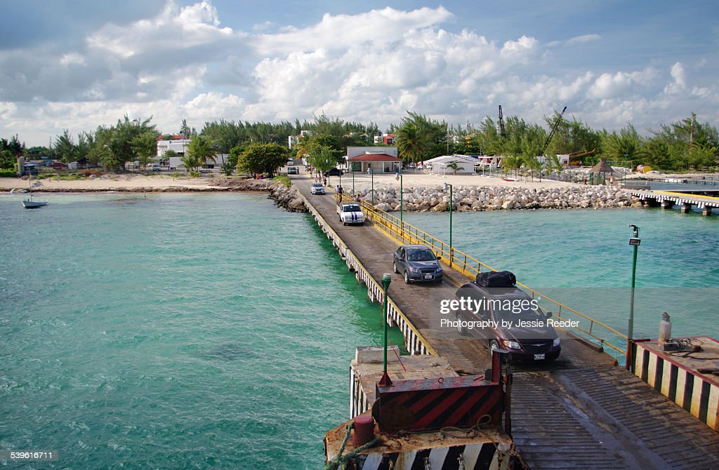 Cars boarding the ferry leaving Cancun : Stock Photo