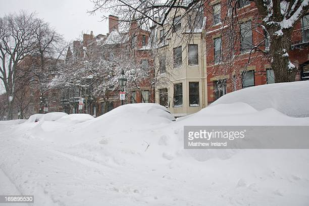 Cars buried in snow, including in a handicapped parking space. Marlborough Street in Boston's Back Bay neighborhood during a massive, early February...