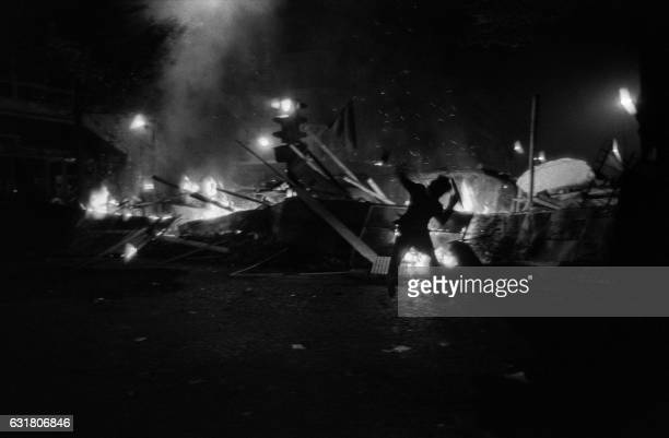 Cars burn at SaintMichel square in Paris on May 25 1968 during the MayJune 1968 events in France