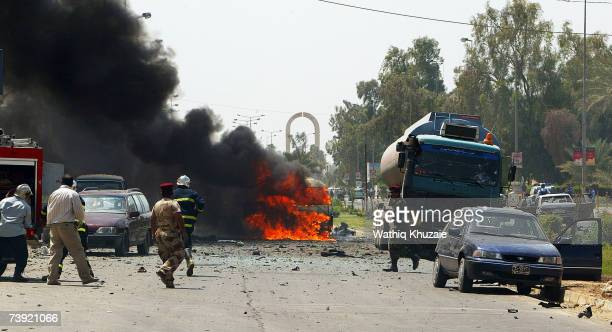 Cars burn at the site of a suicide car bomb explosion in the Jadriya neighborhood on April 19 2007 in Baghdad Iraq A suicide car bomber rammed into a...