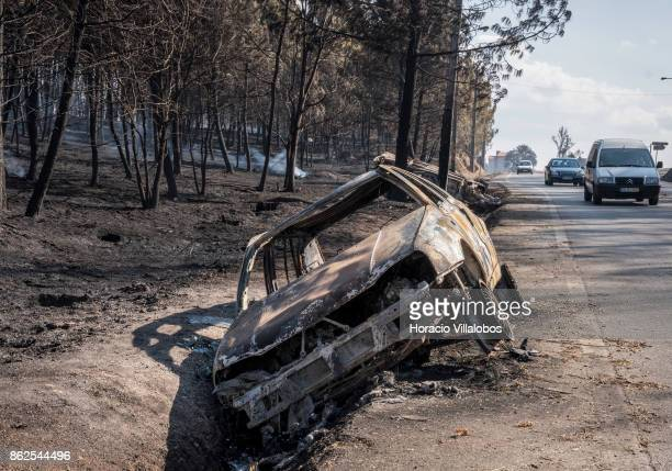 Cars burned by the forest fire are seen at a roadside on October 17 2017 in Oliveira do Hospital Portugal Portugal's forest fires broke out on...