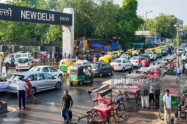 Cars busses and cycle rikshaws are cought in the traffic jam in front of New Delhi Railway Station