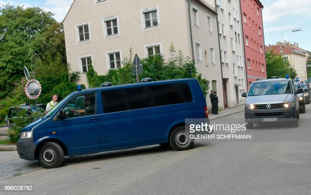 Cars carrying the defendants arrive at the Regional Court of Munich before the proclamation of sentence in the trial against Beate Zschaepe the only...