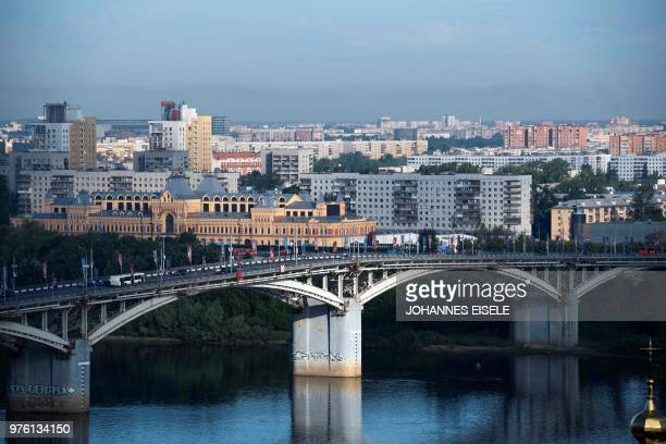 Cars commute on the bridge which leads to the Nizhny Novgorod stadium in the city of Nizhny Novgorod during the Russia 2018 World Cup football...
