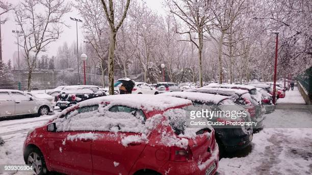 Cars covered in snow at car park in Madrid, Spain