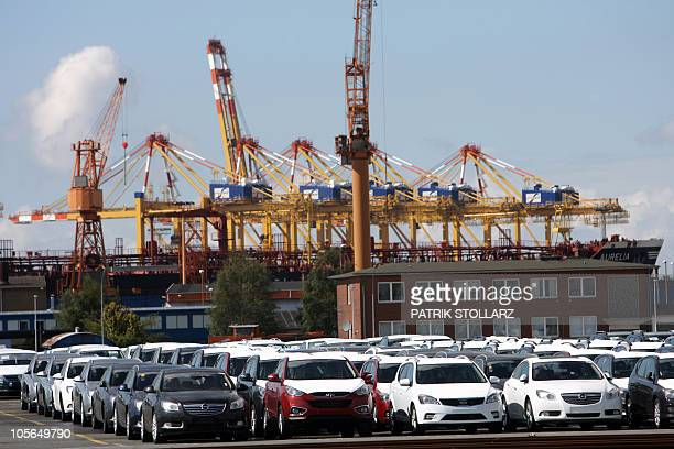Cars covered with protective canvas stand at the car terminal at the harbour of Bremerhaven northern Germany on August 31 2010 The container terminal...