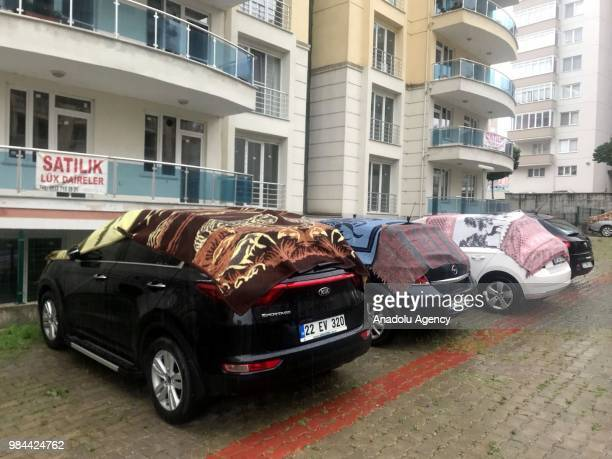 Cars covered with rugs to protect it from possible hail damage are seen as Turkish State Meteorological Service issued a warning on heavy rainfall in...