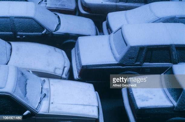 Cars covered with snow in a parking lot US 1994