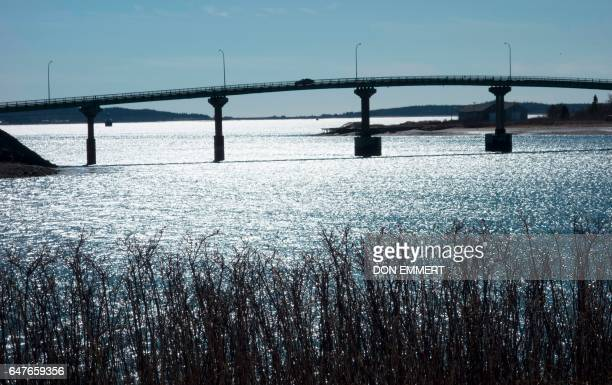 Cars cross over the International Bridge between Lubec Maine and Campobello Island Canada on March 3 2017 as pictured from Campobello Island Canada...