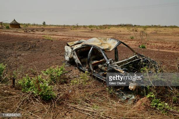 Cars damaged by conflict in northern Burkina Faso