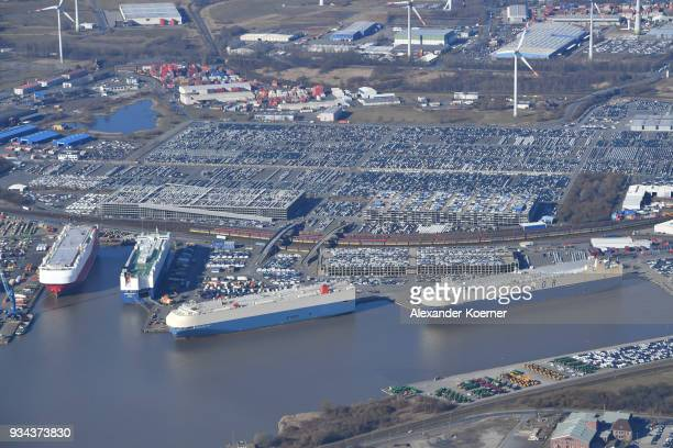 Cars destined for export stand at Bremerhaven port on March 19 2018 in Bremerhaven Germany The new German government is seeking to prevent new...