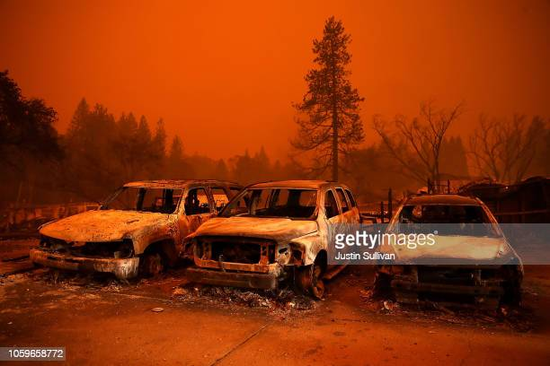 Cars destroyed by the Camp Fire sit in the lot at a used car dealership on November 9 2018 in Paradise California Fueled by high winds and low...